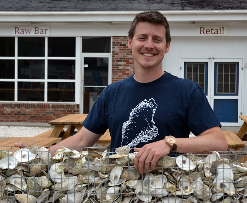 Brendan Parsons stands in front of Shuck Station, at 68 Main St. in Newcastle. The raw bar will open for its second season Saturday, June 2. (Maia Zewert photo)
