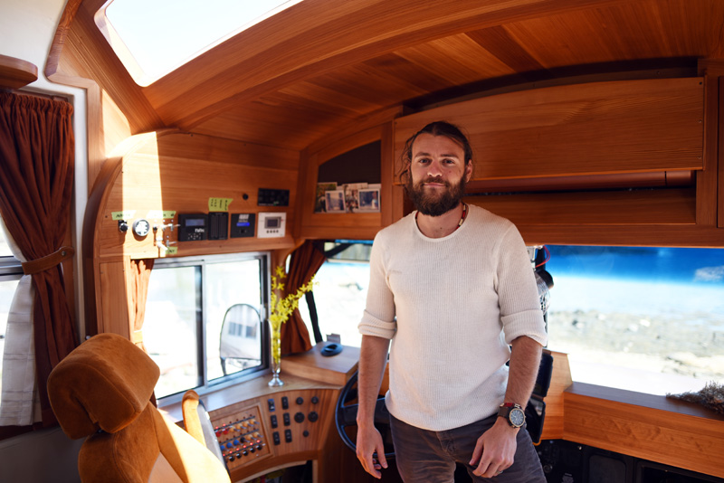 Jeff Osborne stands in the cockpit of his school bus-turned-recreational vehicle Tuesday, May 8. (Jessica Picard photo)