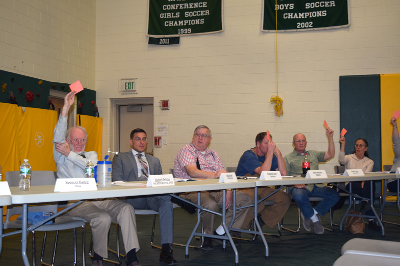 RSU 12 Board of Directors members Keith Marple (second from left) and Richard Cote (third from left) abstain from a vote during the budget-adoption meeting at Chelsea Elementary School on Thursday, May 17. (Jessica Clifford photo)
