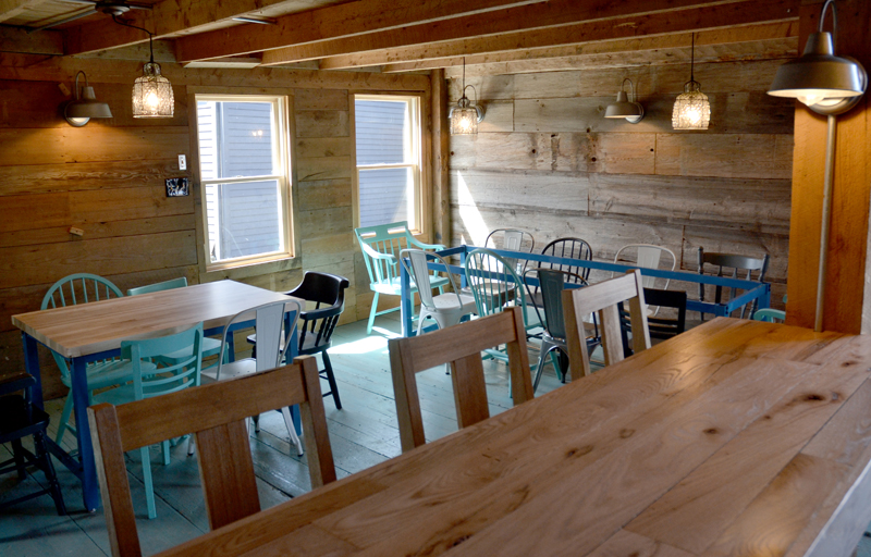 The tasting room at Odd Alewives Farm Brewery in Waldoboro. Sarah and John McNeil preserved as much of the mid-1800s barn as possible. (Maia Zewert photo)