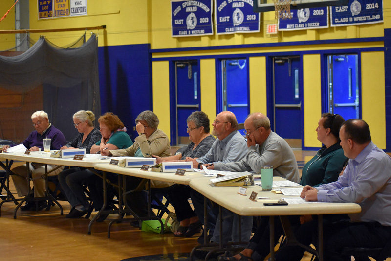 The RSU 40 Board of Directors awaits the opening of the budget-adoption meeting at Medomak Valley High School in Waldoboro on Tuesday, May 15. (Alexander Violo photo)