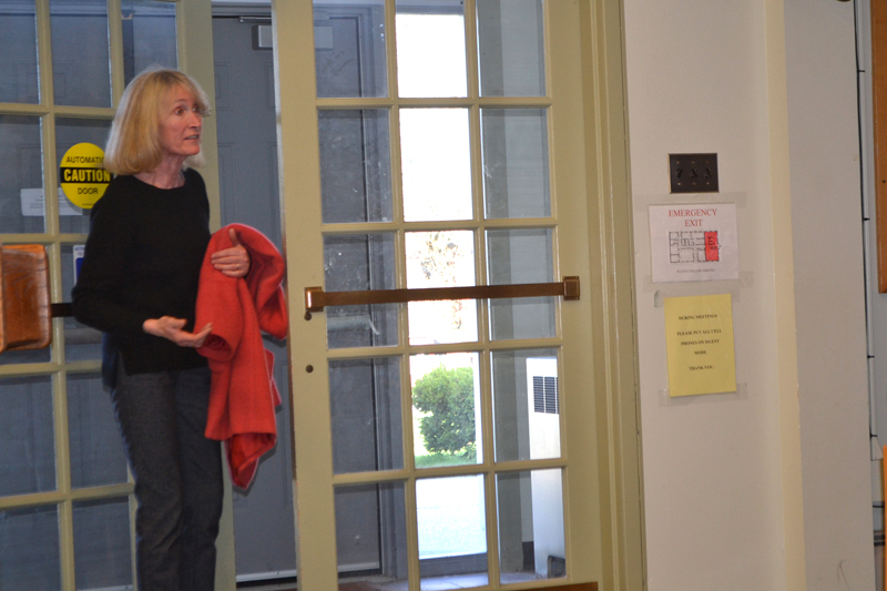 Marston House owner Francoise McCoy exits a public advisory committee meeting at the municipal building Monday, May 7. McCoy objected to the installation of a traffic light at Main Street and Middle Street. (Charlotte Boynton photo)