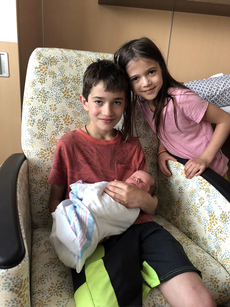 Elijah and Naomi with baby brother Jonah River Jamieson.