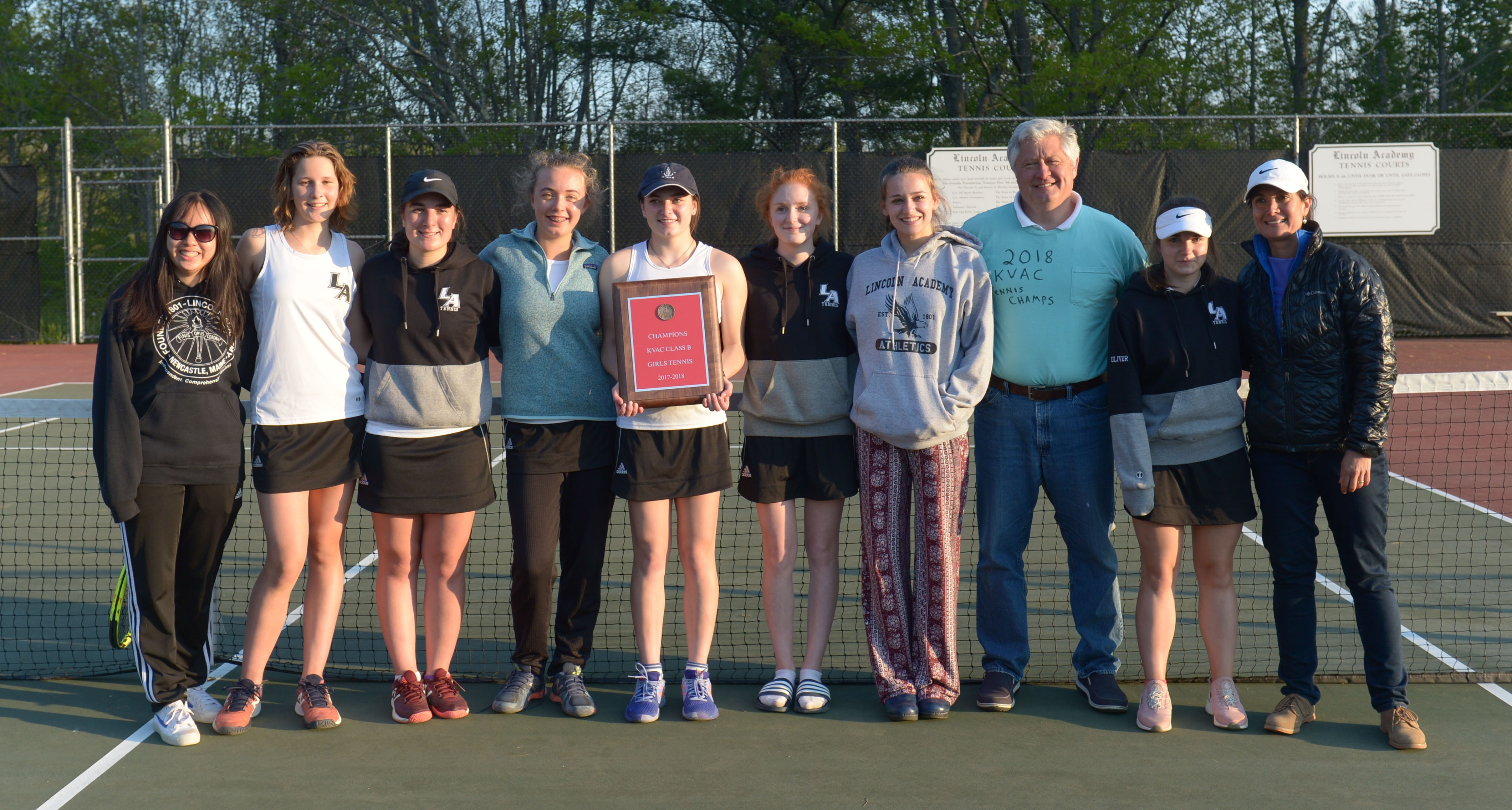 2018 KVAC Class B girls tennis champions, the Lincoln Academy Lady Eagles. Team members are (fromt left) Fiona Liang, Harmony Ingham, Sandra Thelander, Caitlin Cass, Emily Harris, Kate Peters, May Halm, coach Charlie Scimone, Anastasiya Oliver, and assistant coach Liliana Thelander. (Paula Roberts photo)