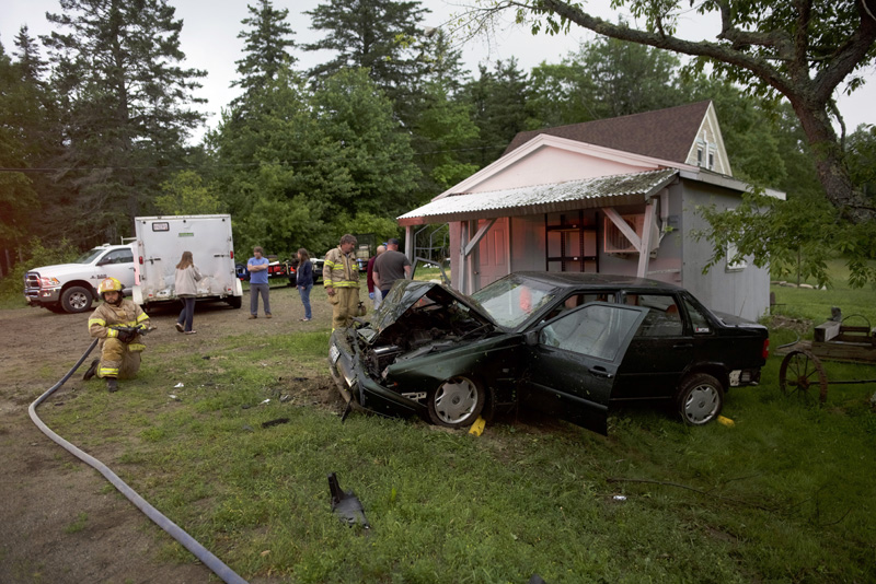 Bristol firefighters work at the scene of a car crash at 1926 Bristol Road in Bristol the evening of Saturday, June 23. (Jessica Picard photo)
