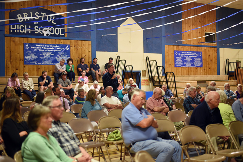 A member of the audience asks a question during a public hearing about the Bristol Mills Dam in the Bristol Consolidated School gym Wednesday, June 20. (Jessica Picard photo)