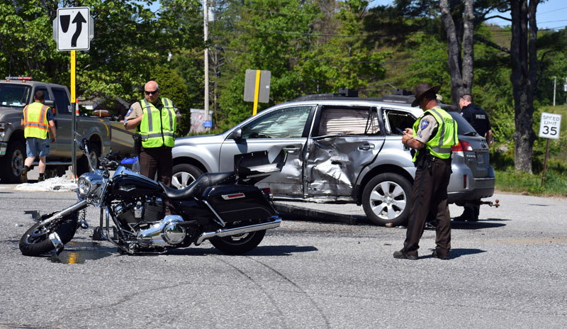 Lincoln County sheriff's deputies work at the scene of a collision between a motorcycle and a station wagon at the intersection of Belvedere Road and Route 1 in Damariscotta the morning of Sunday, June 3. (Alexander Violo photo)