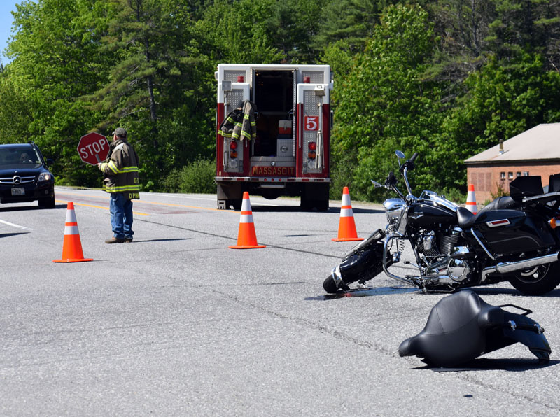 A firefighter directs traffic at the scene of a collision on Route 1 in Damariscotta the morning of Sunday, June 3. (Alexander Violo photo)