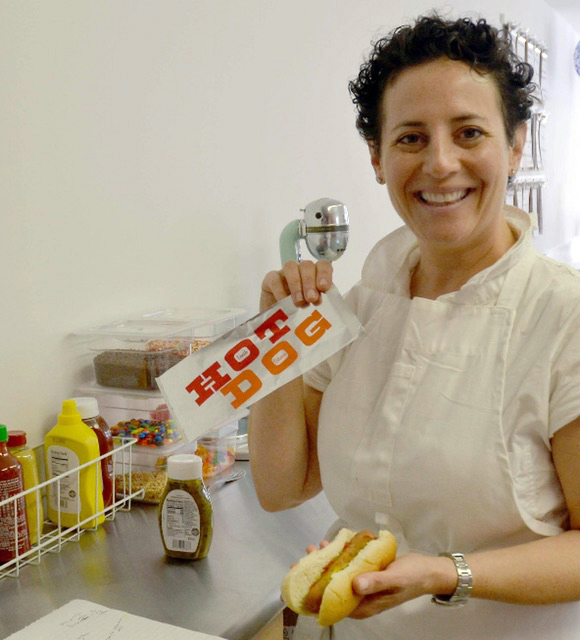 Wicked Scoops owner Jamie Way prepares a hot dog for a customer in the ice cream shop at 95 Main St. in downtown Damariscotta.