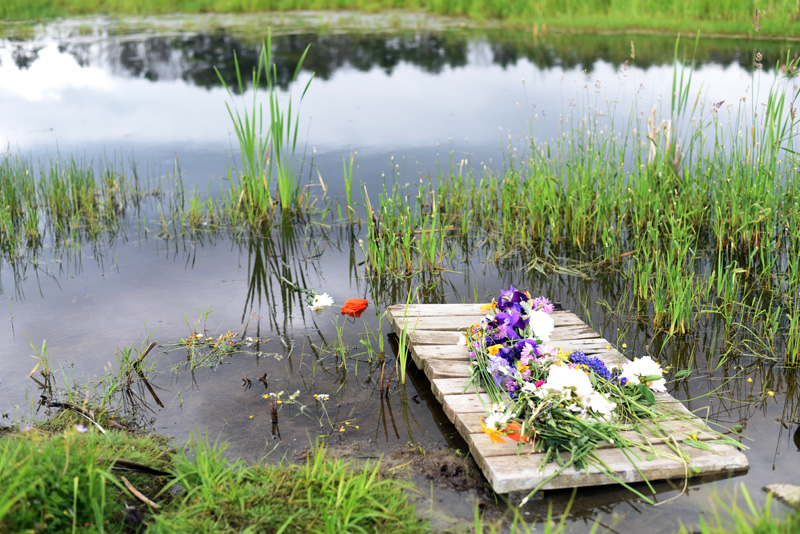 Flowers left by the water at Isabelle Manahan's celebration of life Thursday, June 14. (Jessica Picard photo)