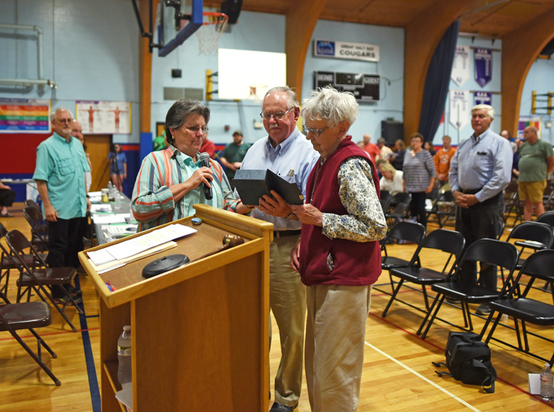 Damariscotta Board of Selectmen Chair Robin Mayer (left) presents Calvin and Marjorie Dodge with the Spirit of America award during annual town meeting at Great Salt Bay Community School on Wednesday, June 13. (Jessica Picard photo)