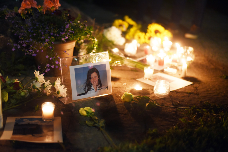 A photo of Isabelle Manahan is surrounded by candles and flowers during a vigil at Great Salt Bay Community School in Damariscotta on Monday, June 11. (Jessica Picard photo)