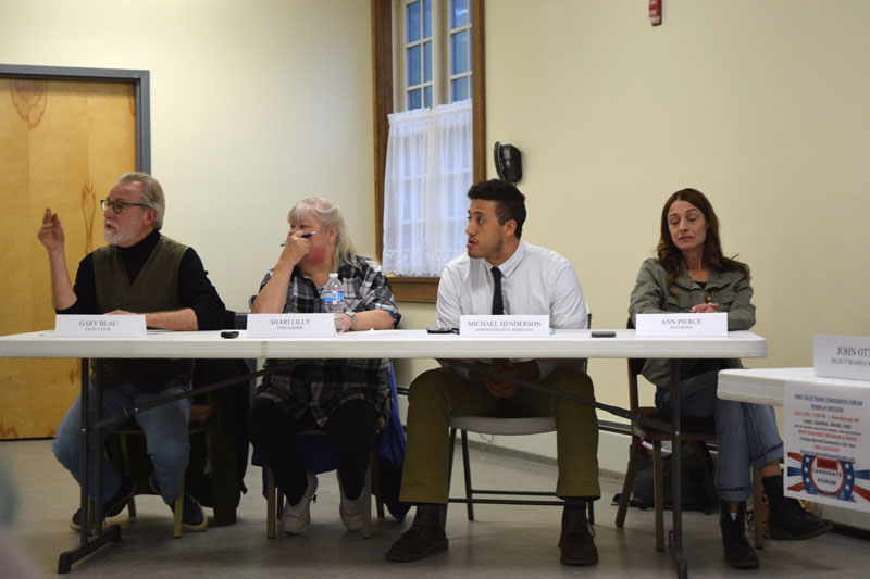 From left: moderator Gary Blau asks a question during the candidates forum at Pownalborough Hall in Dresden on Monday, June 4 as timekeeper Shari Lilly, Dresden Administrative Assistant Michael Henderson, and recorder Ann Pierce look on. (Jessica Clifford photo)