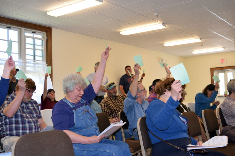 Dresden residents vote during the annual town meeting at Pownalborough Hall on Saturday, June 16. Voters approved all 37 articles, but amended seven. (Jessica Clifford photo)