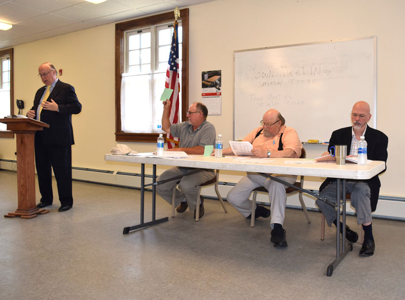 From left: Moderator Robert Lenna, Third Selectman Allan Moeller, Second Selectman Dwight Keene, and First Selectman Dale Hinote discuss warrant article during Dresden's annual town meeting at Pownalborough Hall on Saturday, June 16. (Jessica Clifford photo)