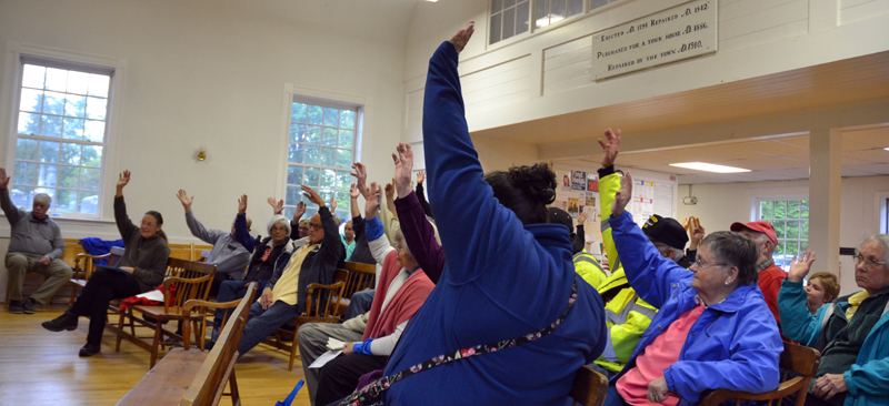 Edgecomb residents vote to buy a new fire truck during a special town meeting at the town hall Monday, June 4. (Maia Zewert photo)
