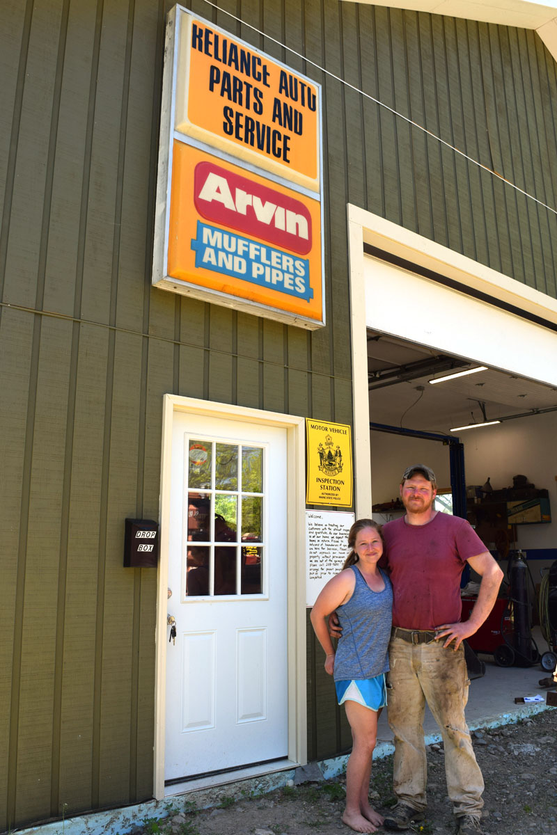 Reliance Auto Repair co-owners Brooke Callahan and Cory Mullins stand in front of their new shop at 106 River Road in Edgecomb. The business recently moved from Wiscasset. (Jessica Clifford photo)
