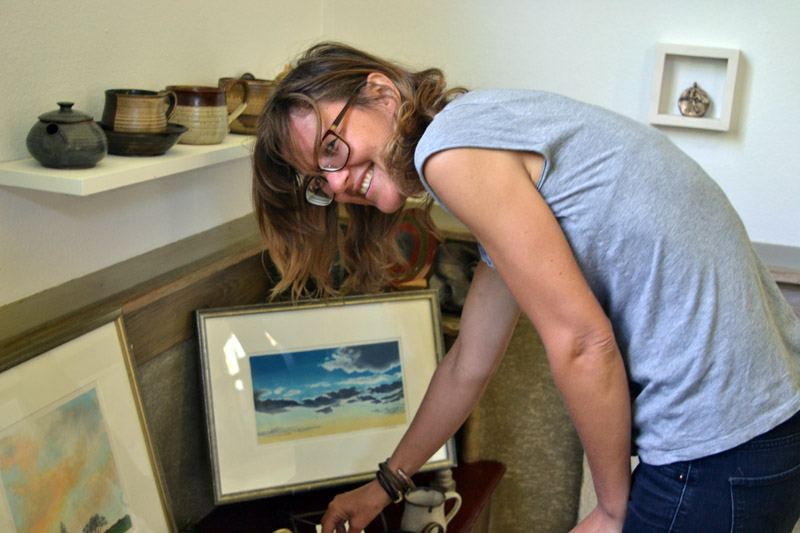 Potter Kila Bates arranges items at Edison Studio on Friday, June 22. (Christine LaPado-Breglia photo)