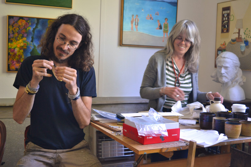 Jewelry-maker Cat Bates and sculptor Daphne Pulsifer gear up for the opening reception at Edison Studio on Friday, June 29. (Christine LaPado-Breglia photo)