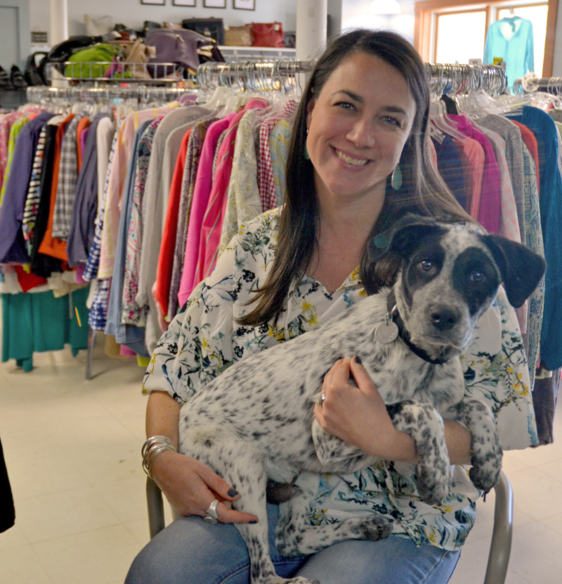 Consigning Women owner Annie Avantaggio and her dog, Patch, in the store at 521 Main St. in Damariscotta. In mid-September, Avantaggio will relocate the shop to 63 Main St. in Newcastle. (Maia Zewert photo)