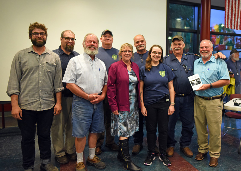 The Newcastle Board of Selectmen presents the Newcastle Fire Department with a copy of the town report, dedicated to the department for its service to the town, Monday, June 18. (Jessica Picard photo)