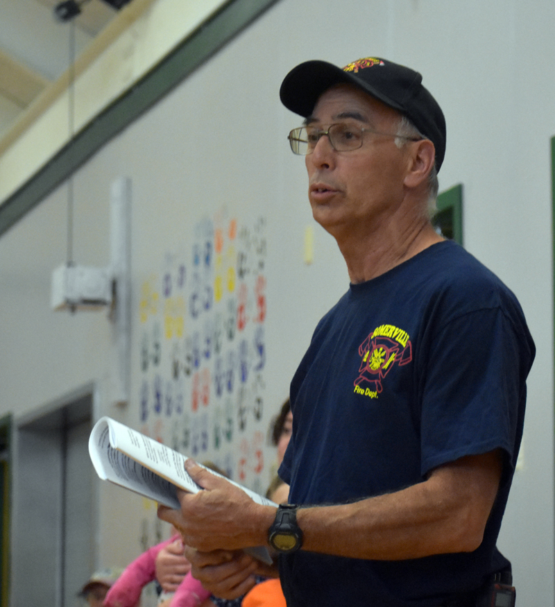 Somerville Fire Chief Michael Dostie speaks in support of funds to pay firefighters $15 per call or training during town meeting at the former Somerville School on Saturday, June 23. (Alexander Violo photo)
