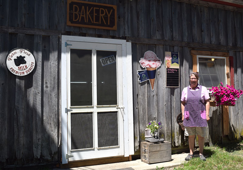 Baker and co-owner Robin Chase in front of Chase Farm and Bakery in Whitefield, which will hold a grand opening Friday, June 29. (Jessica Clifford photo)