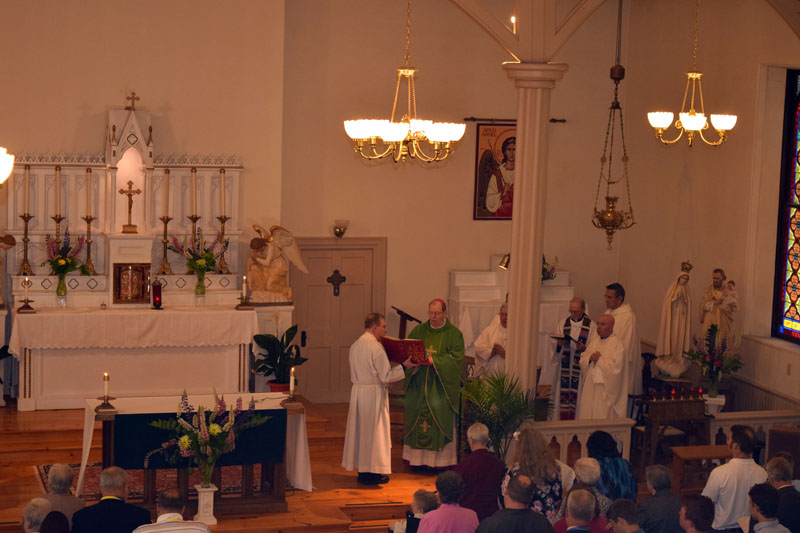 Bishop Robert P. Deeley (center, in green) participates in St. Denis Church's 200th anniversary Mass on Sunday, June 10. (Jessica Clifford photo)