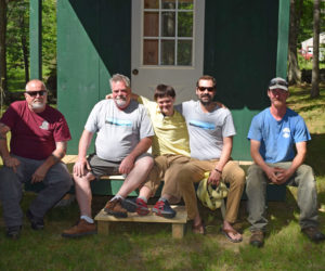 From left: Matt Dorsey, Matthew Jones, John Rankin, Caleb Jones, and Chris Richards sit on the porch of John's new house in Wiscasset. The group delivered the tiny house June 3. (Jessica Clifford photo)