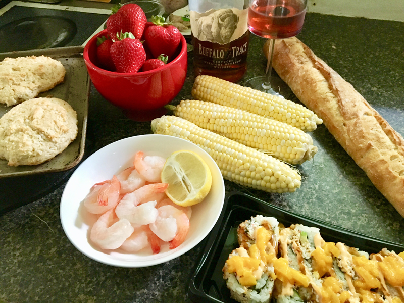 Mise en place for sauteed shrimp with lemon, mango sushi, crusty French bread, corn on the cob, and strawberry shortcake. Oh - and a Manhattan (duh). (Suzi Thayer photo)