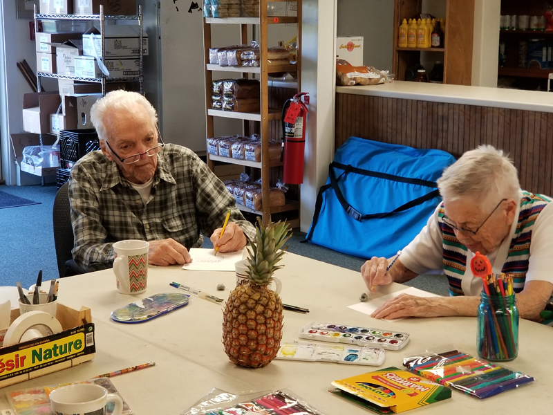 The theme at Hodgdon Green has been Hawaiian, with food and painting classes, and tiki papers featuring pineapples and related things.