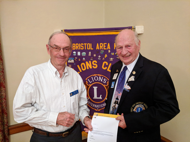 Bristol Area Lion Michael Hope (left) receives a 35-year chevron from Maine District Governor-Elect Neil Iverson. (Photo courtesy Tom Rodrigues)