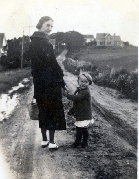 A young Dan Thompson, with neighbor Grace Howard, walks down Southside Road in New Harbor toward home, ca. 1920. (Photo courtesy Merle Thompson)