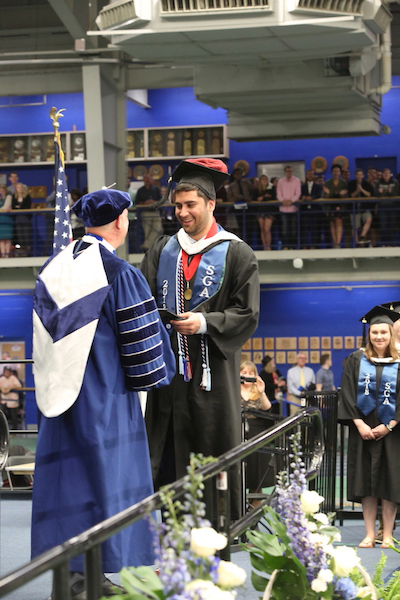 "Syed ""Sammy"" Zaidi receives his diploma at Wheaton College."