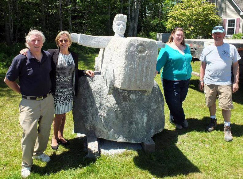 "From left: Bill Royall, Patricia Royall, Margaret Hoffman, and Dick Alden with Bill Royall's sculpture, ""Soapbox Racer."" (Photo courtesy Patricia Royall)"