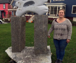 "Isabel Kelley with her sculpture, ""Reservations,"" at McKown Square. (Photo courtesy Patricia Royall)"