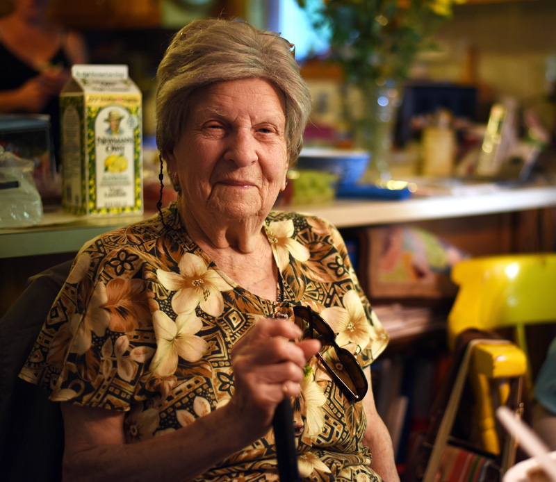 Georgina Rayburn poses with Bristol's Boston Post Cane in her home Friday, July 20. (Jessica Picard photo)