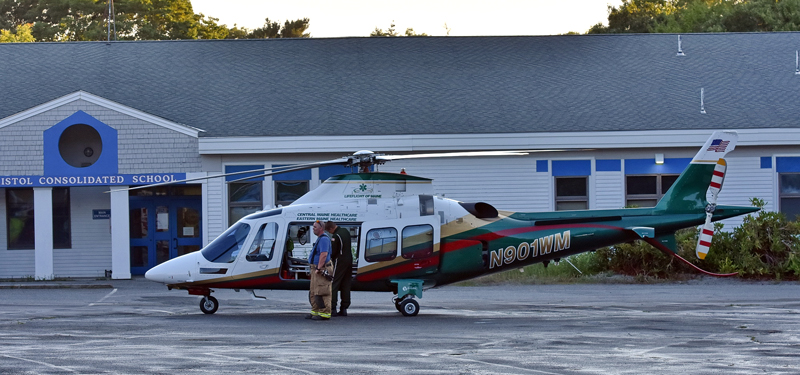 A LifeFlight helicopter waits at Bristol Consolidated School on Monday, July 9. The helicopter flew a man injured in a crash near Pemaquid Point to a Lewiston hospital, according to law enforcement. (Photo courtesy Sherrie Tucker)