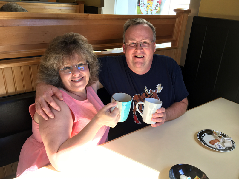 The Penalty Box owners Lisa and Kent Boucher share a cup of coffee during breakfast. Their Damariscotta restaurant now serves breakfast Saturday and Sunday. (Suzi Thayer photo)