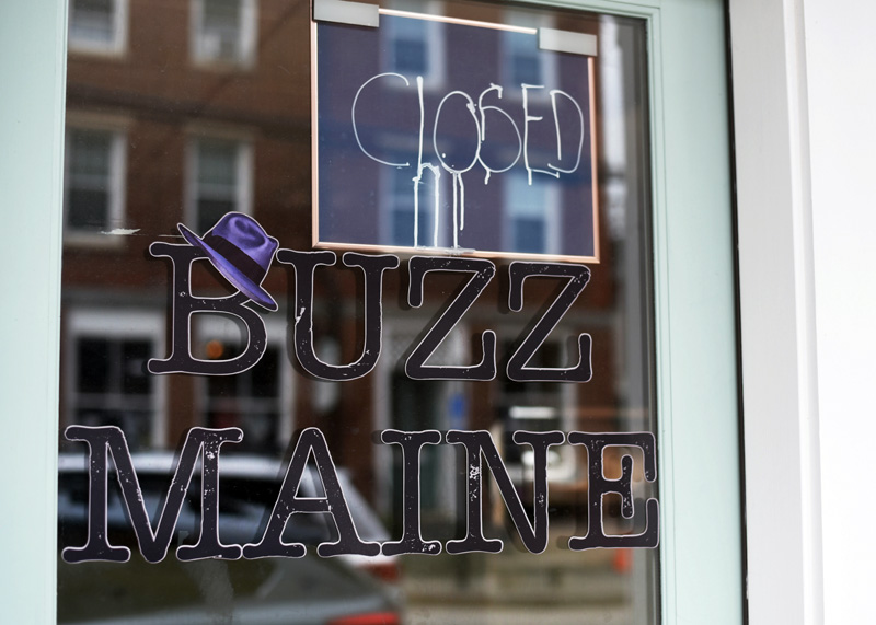 A closed sign on the door of Buzz Maine, at 133 Main St. in Damariscotta. The business closed Saturday, June 30, with the owner telling members she plans to reopen elsewhere next year. (Jessica Picard photo)
