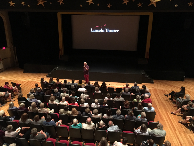 Eliot Daley addresses the audience at Lincoln Theater on the evening of Friday, July 27. (Photo courtesy Andrew Fenniman)