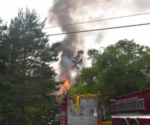 Flames and smoke rise from a house fire on Calls Hill Road in Dresden on Monday, July 16. (Jessica Clifford photo)