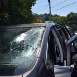 Metal Object Goes Through Windshield of Moving Car, No Injuries