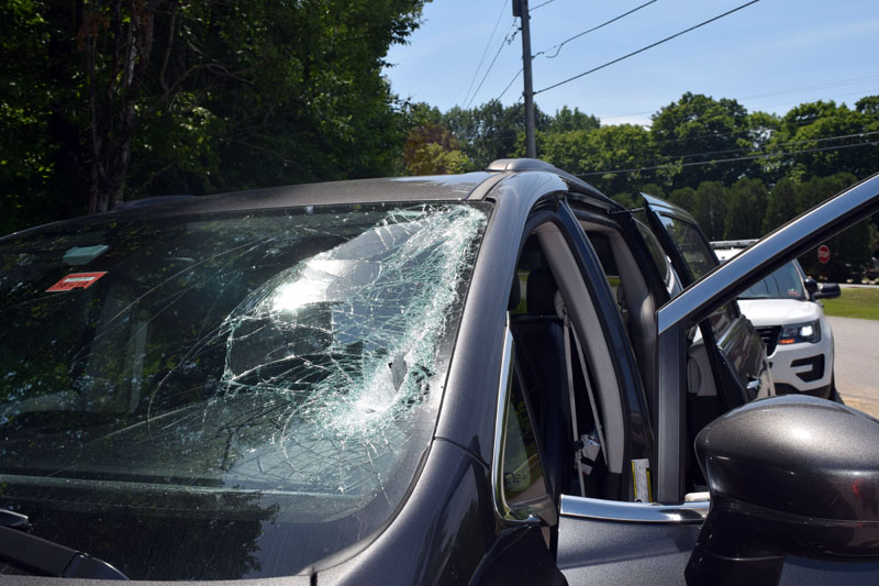 Four international student workers in a company vehicle were not hurt when a metal object from a passing truck went through the vehicle's windshield on Route 27 in Edgecomb the morning of Thursday, July 5. (Jessica Clifford photo)