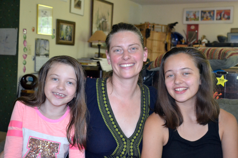 Elise Voigt relaxes at home on the afternoon of Friday, July 6 with two of her three daughters, Scarlet Pope (left) and Iris Pope (right). (Christine LaPado-Breglia photo)