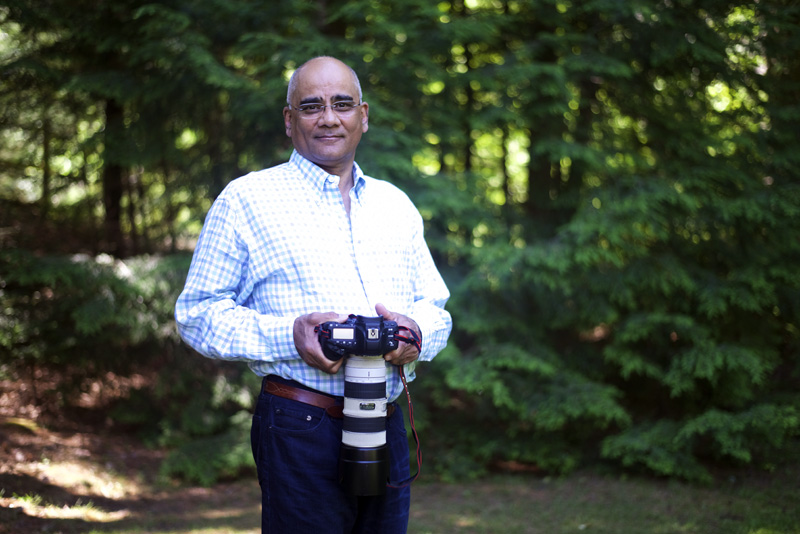 Dr. Rifat Zaidi poses with his camera in Newcastle, Thursday, July 5. (Jessica Picard photo)