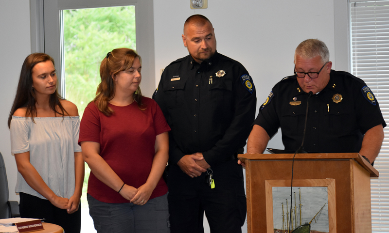 Officer Thomas Bartunek (second from right) stands with his wife and daughter and Police Chief William Labombarde during a medal ceremony at the Waldoboro municipal building Tuesday, July 24. (Alexander Violo photo)