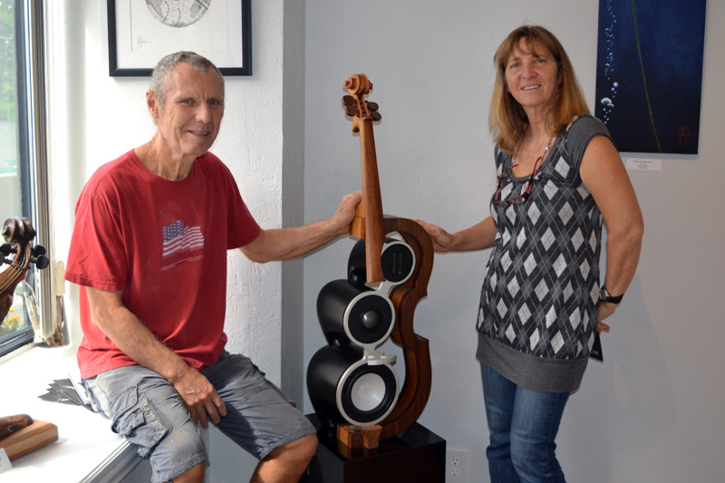 "Philippe and Jacqueline Guillerm with one of Philippe Guillerm's cello-shaped ""sculptural speakers."" (Christine LaPado-Breglia photo)"