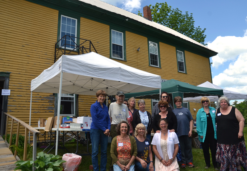 Whitefield Library volunteers stand in front of the Arlington Grange, which houses the library, during an open house June 9. The volunteers are researching the possibility of buying the hall. (Maia Zewert photo, LCN file)