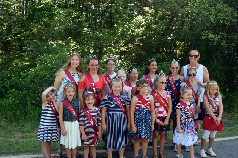 The Pittston Fair Maine Strawberry Pageant participants, with Pageant Director Liz Chaisson (back right), pose for a photo before walking in the Whitefield Fourth of July parade. (Jessica Clifford photo)